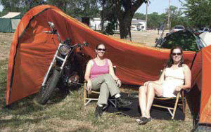 Invite your biker girl for a romantic camping dating.