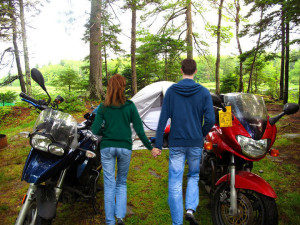 Biker girl and man plan a camping dating.